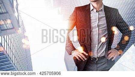 Confident Businessman With Hands On Waist, Looking For Approaches To Tasks Solutions. Low Angle New