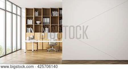 Interior View With Panoramic Window And Empty Wall, Deviding The Office Area. Wooden Cabinet In Beig