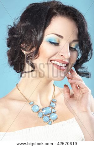 Portrait of beautiful woman with perfect make up and glossy hair