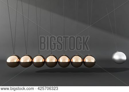 Newton Cradle Balance Balls. Seven Balls, Made Of Golden Steel And The Silver One, Hanging In Line O