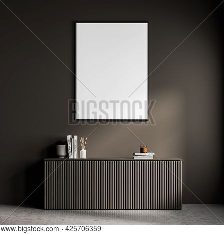 Empty Mockup Banner On The Wall Of Dark Brown Waiting Room With Fluted Sideboard. Vases, Books And C