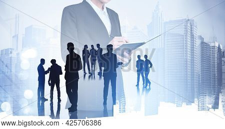 Silhouettes Of Businesspeople Who Are Working In Corporate Business Taking Note, Reviewing A Report.