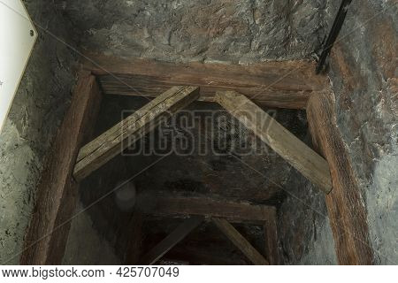 Long Lighten Tunnel Through Gypsum Mine With Wooden Beams In North Of Thailand.