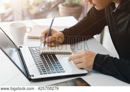 Online Businessmen Who Work On Computers, Laptops, Cell Phones And Tablets From Home Office.