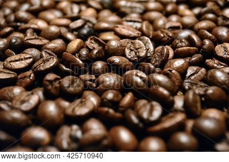 Roasted Coffee. Roasted Coffee Beans. Background. Artistic Blur