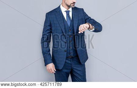 Confident Businessman Look At Time. Business Success. Successful Man In Businesslike Suit