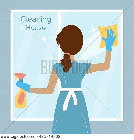 Woman In A Blue Uniform Is Washing The Window With Duster, Holding A Spray In Her Hands