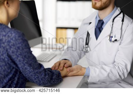 Friendly Doctor Reassuring His Female Patient, Close-up. Medical Ethics And Trust Concept, Medicine