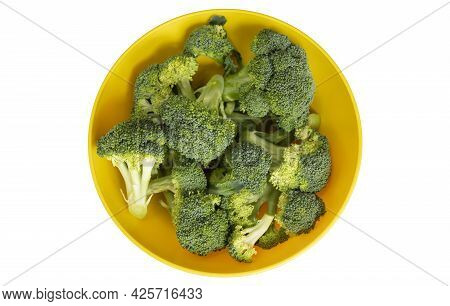 Fresh Broccoli In Yellow Bowl Isolated On White