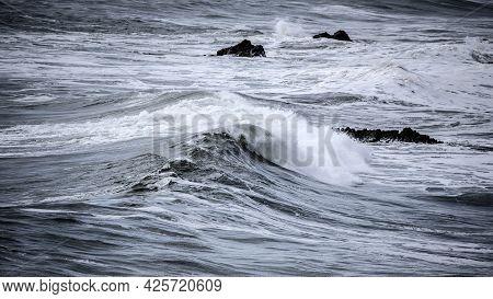 Beautiful Dark Dramatic Toned Fine Art Seascape Image Of Breaking Waves On Atlantic Ocean In Devon E