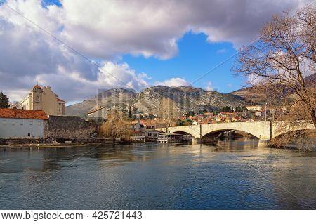 View Of Trebinje City  On Winter Day. Kameni Most ( Stone Bridge  ) Over River Trebisnjica. Bosnia A