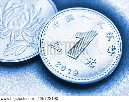 1 One Chinese Yuan Coins Close-up. Blue Tinted Illustration About The Economy, Business, Money And F