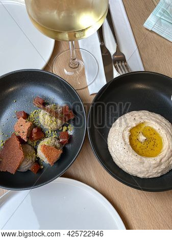 Fish Egg Paste Taramasalata Or Tarama With Chicken Liver Pate Or Paste And White Wine At Lunch Table