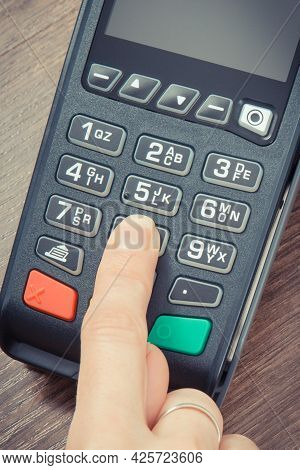 Payment Terminal And Finger Entering Pin Code. Credit Card Reader Using For Cashless Paying. Finance