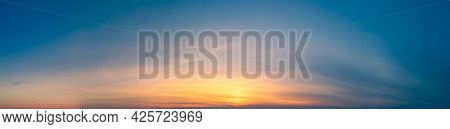 Sunset Wide Panorama Of The Sunset In Clear Skies For The Site Header. Wide Panorama Of Blue Sky Wit