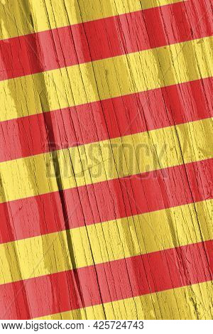 Catalan Flag On Dry Wooden Surface, Cracked With Age. Vertical Background, Wallpaper Or Backdrop Wit