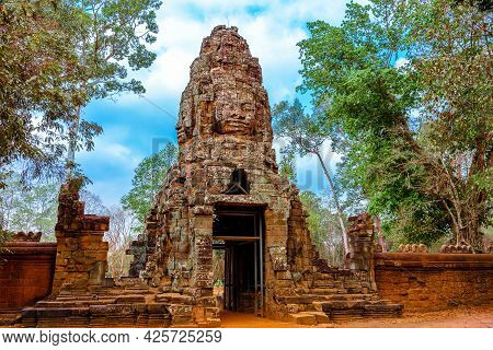 Face Carved Stone Arched Entrance To Ta Prohm Temple In Angkor Thom, Siem Reap, Cambodia. Ta Prohm T