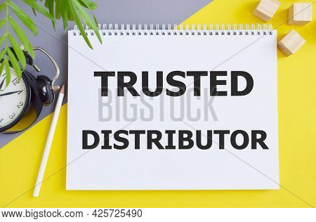 Trusted Distributor Text Written In Notebook, Business Concept