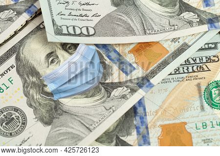 Covid-19 Coronavirus In Usa, 100 Dollar Money Bill With Franklin In Surgical Face Mask, Macro. Covid