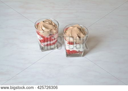 Dessert With Strawberries, Nuts And Chocolate Cream In Portioned Cups