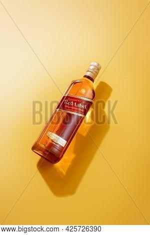Phuket, Thailand- Jan 2021. Johnnie Walker Red Label Blended Whisky Isolated On Color  Background. J