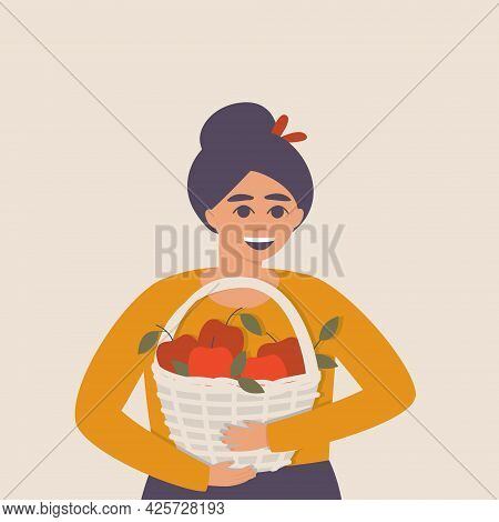 Happy woman with a basket of apples in her hands. Ripe apples in a basket. Fresh harvest of red apples. Autumn card with the harvest. Flat vector illustration.