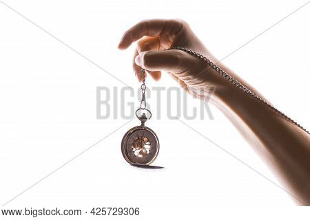 Vintage Pocket Watch On A Chain In A Womans Hand. Time Passes, The Moment Has Come,