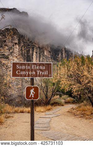 Santa Elena Canyon Trail Sign Medium With Fog Over The Canyon