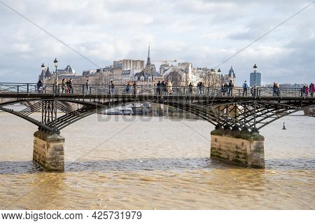 Paris, France, 22 December 2019 - Bridge Over The River Seine With A View Of The Island Of Cité In P