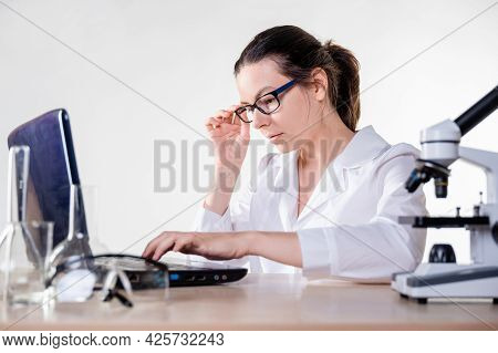 Big Data In Medicine And Pharmacology, Concept. A Young Woman, A Laboratory Assistant Or A Researche