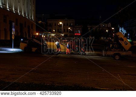 Kazan, Russia - June 15, 2021: Road Workers With A Shovel And Pneumatic Hammer Drill Equipment Repai