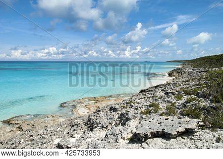 The Scenic View Of A Rocky Shore On Half Moon Cay Uninhabited Island (bahamas).