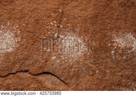 Splattering Pictographs On Wall At Peekaboo Spring In Canyonlands National Park