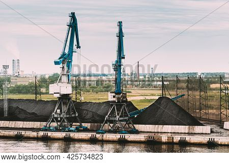 Coal Production, Cranes And Coal Loading At The Port Terminal. Industrial Port Terminal.