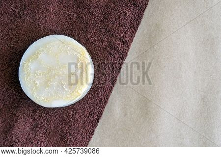 Round Natural Handmade Soap On Braun Fluffy Terry Towel. Hygiene, Body Care And Health Concept. Top