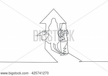 Single Continuous Line Drawing Of Young Beauty Arabian Manager Facing Her Superhero Shadow On The Wa