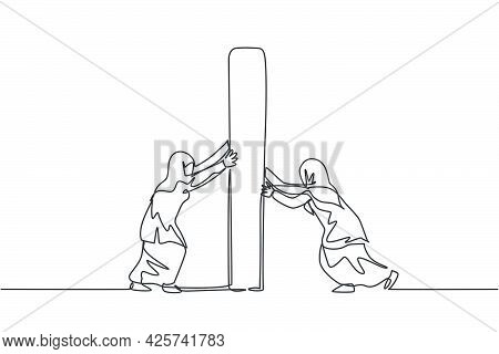 Single One Line Drawing Of Two Young Arabian Businesswomen Pushing The Challenge Wall. Business Fina