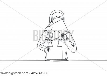 Single One Line Drawing Of Young Arabian Businesswoman Build Puzzle Into Up House Building. Business
