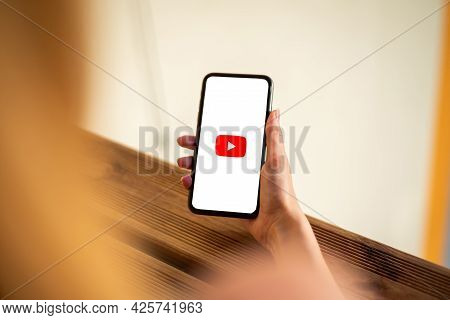 Riga, Latvia - July 3, 2021: Woman Holding Phone With Youtube Logo On The Screen