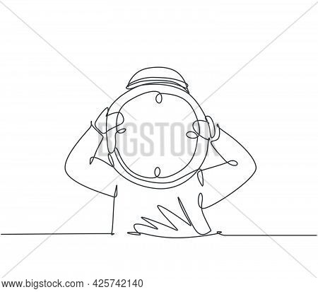 Single One Line Drawing Of Young Arabian Business Man Holding Giant Analog Clock In Front His Head.