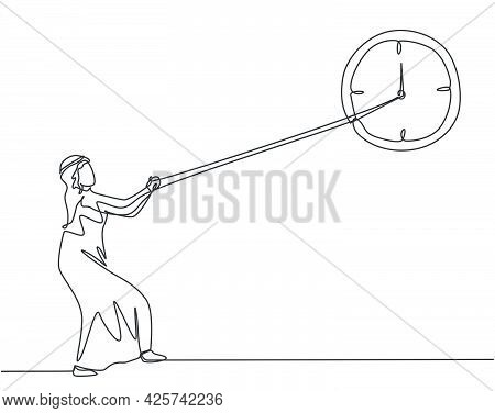 Single Continuous Line Drawing Young Arab Business Man Pulling Clockwise Of Big Analog Wall Clock Wi