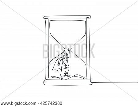 Single One Line Drawing Of Young Arabian Business Woman With Wing Flying To Get Out From Hourglass.