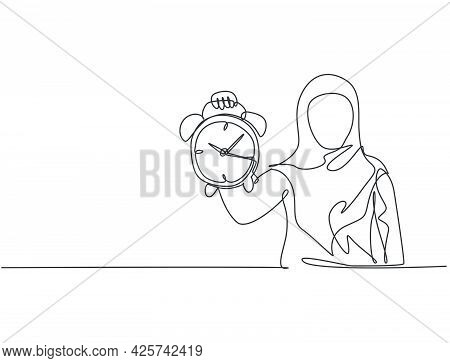 Single One Line Drawing Of Young Arabian Business Woman Holding Analog Alarm Clock With Her Hand. Ti