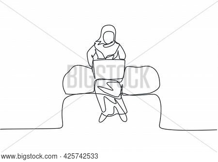 Single One Line Drawing Of Young Arabian Business Woman Sitting On Sofa And Typing Business Proposal