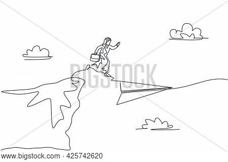 Single Continuous Line Drawing Young Arabian Business Man Jumping From Top Of Mountain To Flying Pap