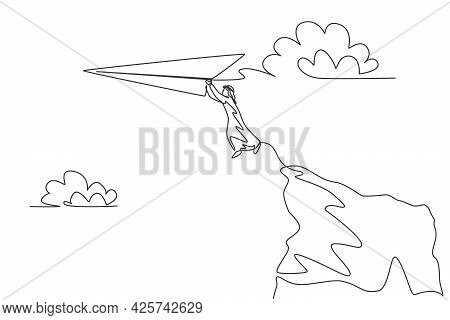 Single One Line Drawing Of Young Arabian Business Man Jumping From Cliff Top To Reach Paper Airplane