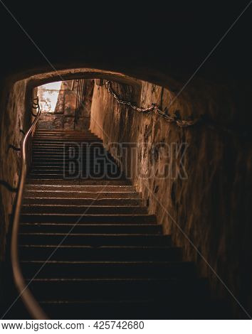 Stairs Up Out Of The Tunnel Where The Golden Sun Shines. Dramatic Feeling. Hiiumaa, Estonia
