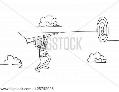 Single One Line Drawing Of Young Arab Business Woman Hanging On Flying Paper Plane To Hit Target. Bu