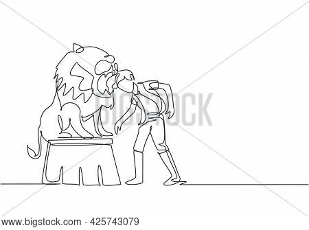 Single One Line Drawing Of A Lion Stands On A Circus Chair While Following The Instructions Of His T