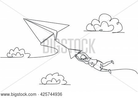 Single One Line Drawing Of Young Businesswoman Hanging On Flying Paper Plane. Business Obstacle And